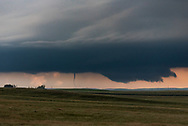This was the 2nd twister that I saw outside of Buffalo, South Dakota. It danced around, touching the ground briefly and lifting again a few times. But the wall cloud on the right was beginning to show very rapid motion. It was about to drop a wedge tornado, and I knew I had to get closer to get a better view.