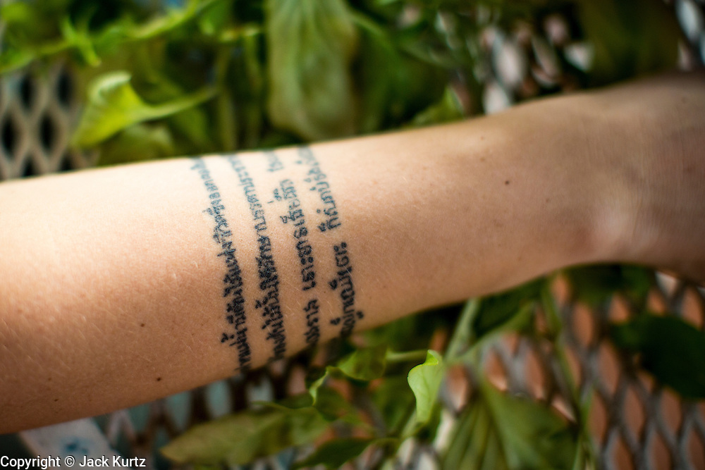 01 APRIL 2013 - BANGKOK, THAILAND:    Amy Hupe has a bible verse tattooed on her arm in Thai and Khmer (Cambodian). PHOTO BY JACK KURTZ