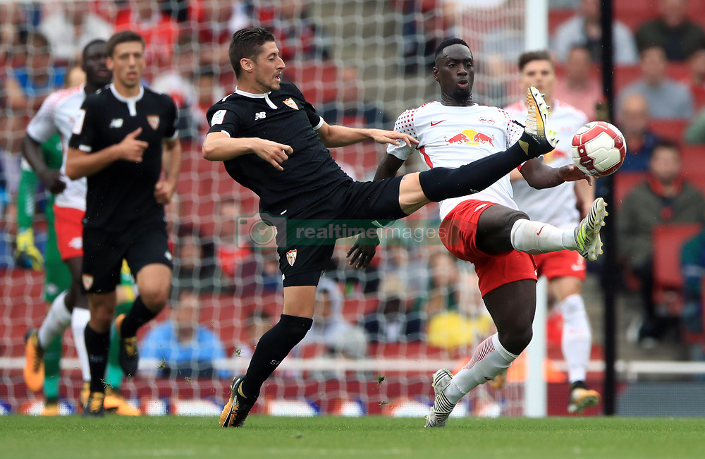RB Leipzig's Jean-Kevin Augustin (right) and Sevilla's Sergio Escudero battle for the ball during the Emirates Cup match at the Emirates Stadium, London.