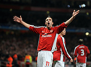 Robin Van Persie of Arsenal celebrates scoring from the penalty spot for Arsenal's first goal during the UEFA Champions League First knockout round, First Leg match between Arsenal and A.S. Roma at Emirates Stadium on February 24, 2009 in London, England