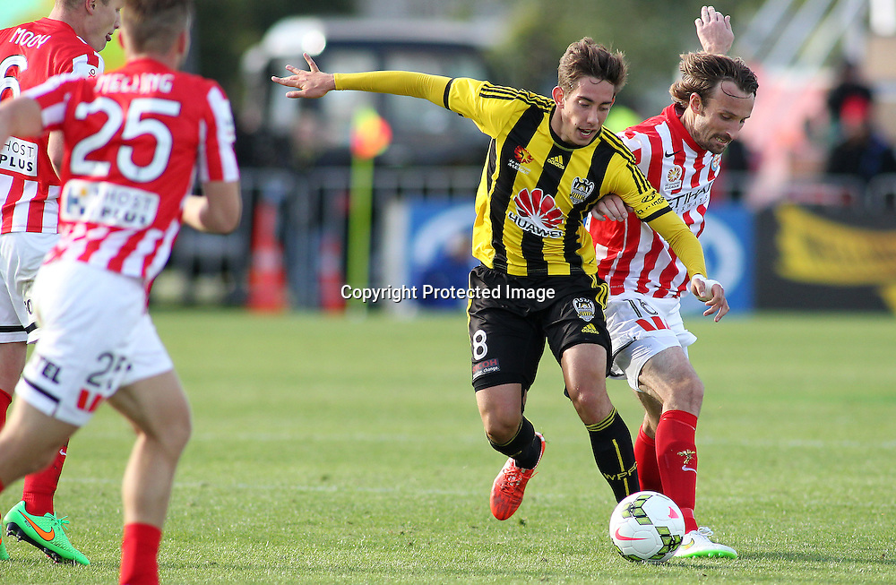 Phoenix' Alex Rodriguez competes for the ball with Melbournes' Josh Kennedy during the A-League football match between the Wellington Phoenix & Melbourne City, at the Hutt Recreational Ground, Wellington, 14 February 2015. Photo.: Grant Down / www.photosport.co.nz