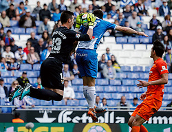 BARCELONA, May 14, 2018  Malaga's goalkeeper Andres Prieto (L) and RCD Espanyol's Gerard Moreno (C) compete during a Spanish league match between RCD Espanyol and Malaga in Barcelona, Spain, on May 13, 2018. RCD Espanyol won 4-1. (Credit Image: © Joan Gosa/Xinhua via ZUMA Wire)
