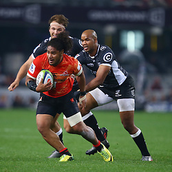 DURBAN, SOUTH AFRICA - JULY 15: JP Pietersen of the Cell C Sharks looks to tackle Mifiposeti Paea of the Sunwolves during the Super Rugby match between the Cell C Sharks and Sunwolves at Growthpoint Kings Park on July 15, 2016 in Durban, South Africa. (Photo by Steve Haag/Gallo Images)
