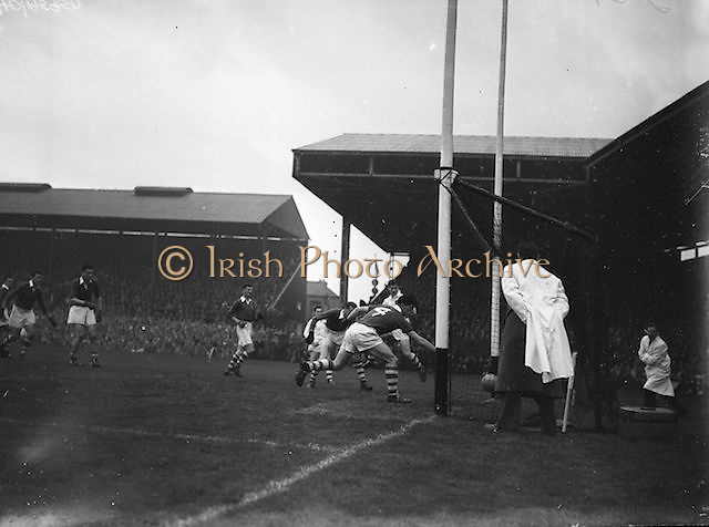 Cork players try to save the ball from rolling into the goal during the All Ireland Senior Gaelic Football Championship Final, Cork v Galway in Croke Park on the 7th October 1956. Galway 2-13 Cork 3-7.