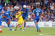 AFC Wimbledon defender Will Nightingale (5) battles for possession during the EFL Sky Bet League 1 match between AFC Wimbledon and Wycombe Wanderers at the Cherry Red Records Stadium, Kingston, England on 31 August 2019.