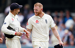 England's Ben Stokes (right) shares a laugh with his captain Joe Root as they walk off for the tea break during day two of the First NatWest Test Series match at Lord's, London.