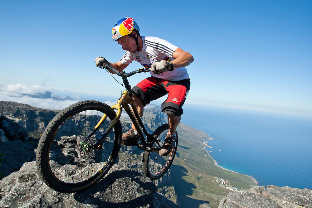 Professional trials bike rider, Kenny Belaey performs tricks a staggering 3558ft above sea level on Table Mountain,  which overlooks Cape Town, South Africa.<br /> Kenny hiked up Platteklip Gorge with his bike in the dark to summit the mountain before sunrise.