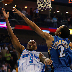 Mar 31, 2010; New Orleans, LA, USA; New Orleans Hornets guard Marcus Thornton (5) shoots over Washington Wizards guard Shaun Livingston (2) during the first half at the New Orleans Arena. Mandatory Credit: Derick E. Hingle-US PRESSWIRE