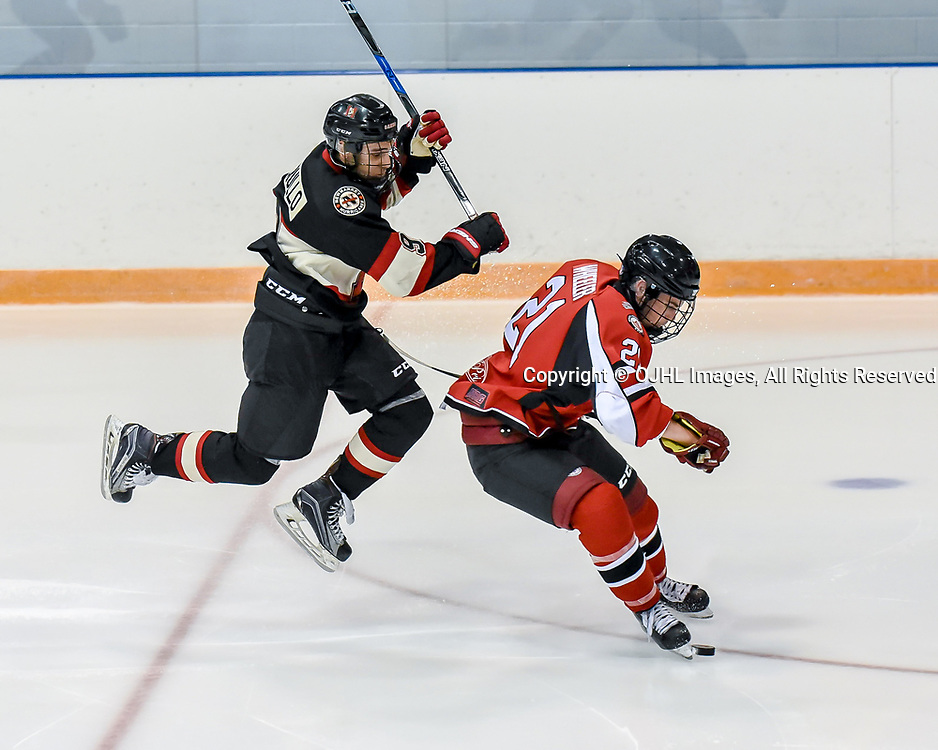 NEWMARKET, ON - SEP 14: Ontario Junior Hockey League game between the Newmarket Hurricanes and the Stouffville Spirit. Quintin Wheeler #21 of the Stouffville Spirit protects the puck from Alex Ierullo #9 of the Newmarket Hurricane.<br /> (Photo by Phillip Sutherland / OJHL Images)