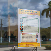 A sign informing the public about the Zika virus is taped on the door of a municipal building in Guayama, Puerto Rico. The Zika virus is spreading rapidly in Puerto Rico and pregnant women are at risk for becoming infected with Zika which can cause microcephaly and other birth defects. If the current trends continue, at least 1 in 4 people, including women who become pregnant, may become infected with Zika.