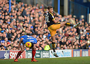 Cambridge United Forward Ben Williamson and Portsmouth defender Enda Stevens during the Sky Bet League 2 match between Portsmouth and Cambridge United at Fratton Park, Portsmouth, England on 27 February 2016. Photo by Adam Rivers.