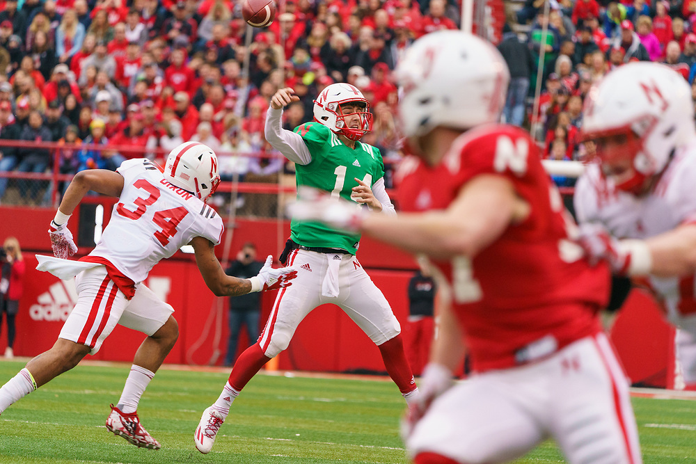 Tristan Gebbia #14 throws under pressu during Nebraska's annual Spring Game at Memorial Stadium in Lincoln, Neb., on April 21, 2018. © Aaron Babcock