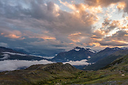 Sunset light on Hogback Glacier as storm clouds recede in Thompson Pass in Southcentral Alaska. Summer.