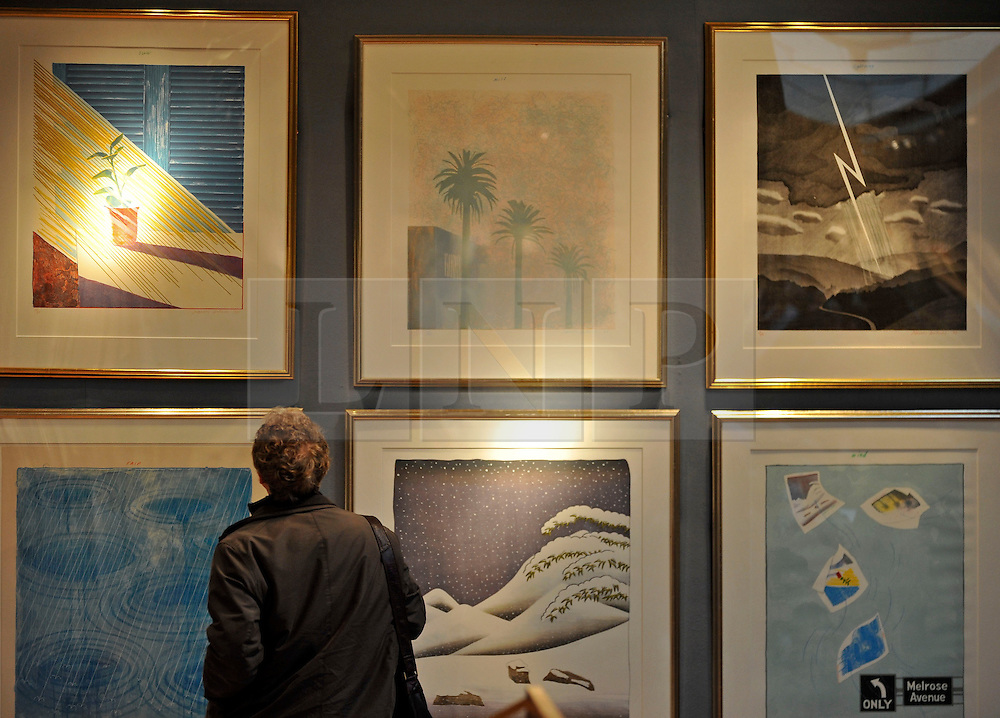 © Licensed to London News Pictures. 17/02/2012, London, UK. A man looks at prints by Hockney before the auction. An auction of items by British artist David Hockney takes place at Christie's in London's South Kensington today, 17th February 2012. It features over 100 works by Hockney, including etchings, lithographs, drawings and photography. They are expected to sell for over £1m. The sale spans over 40 years of Hockney's career. Photo credit : Stephen Simpson/LNP
