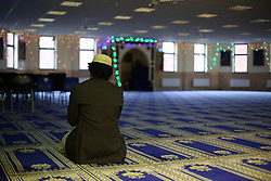 © Licensed to London News Pictures. 07/02/2015. Leeds, UK. A lone worshiper prays inside Leeds Grand Mosque in West Yorkshire as mosques all over Britain open their doors to non-muslims to explain their faith beyond the hostile headlines. This is the second 'Visit My Mosque Day' with the first being last year. Organised by the Muslim Council of Britain, last year's event attracted hundreds of visitors for tours, talks and tea. Photo credit : Ian Hinchliffe/LNP