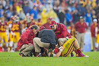 17 October 2012: Quarterback (7) Matt Barkley of the USC Trojans lays on the ground with medical attention after getting sacked by the UCLA Bruins during the second half of UCLA's 38-28 victory over USC at the Rose Bowl in Pasadena, CA.