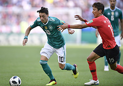 KAZAN, June 27, 2018  Mesut Oezil (L) of Germany vies with Jung Wooyoung of South Korea during the 2018 FIFA World Cup Group F match between Germany and South Korea in Kazan, Russia, June 27, 2018. (Credit Image: © Chen Yichen/Xinhua via ZUMA Wire)