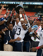 Howard University head coach Gary Harrell and Keith Pough (13) hoist the game trophy up at the end of the AT&T Nation's Classic Football game with Howard University and Morehouse College. Howard won the game  30-27 at RFK Stadium in Washington, DC  (Alan Lessig)Alan Lessig Photography.http://lessigphotography.photoshelter.com/