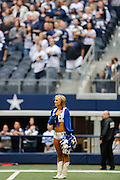 A Dallas Cowboys cheerleader holds her hand over her heart during the National Anthem at Cowboys Stadium in Arlington, Texas, on December 23, 2012.  (Stan Olszewski/The Dallas Morning News)