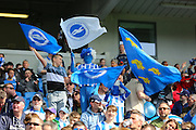Young Brighton fans with flags during the Sky Bet Championship match between Brighton and Hove Albion and Burnley at the American Express Community Stadium, Brighton and Hove, England on 2 April 2016. Photo by Phil Duncan.