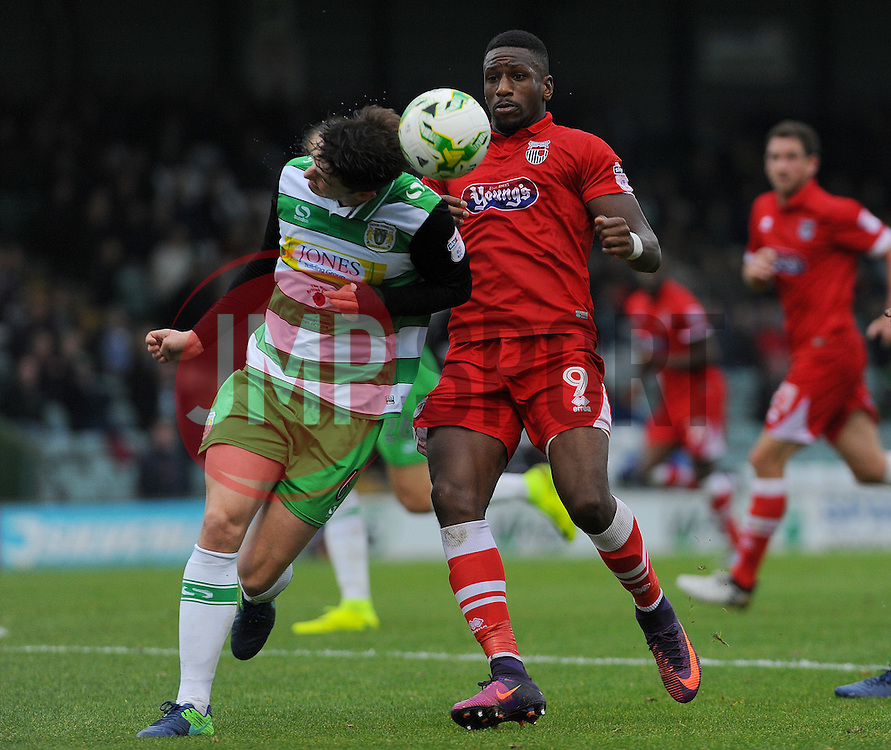 Alex Lacey of Yeovil Town competes with Omar Bogle of Grimsby Town  - Mandatory by-line: Nizaam Jones/JMP - 29/10/2016/ - FOOTBALL - Hush Park - Yeovil, England - Yeovil Town v Grimsby Town - Sky Bet League Two
