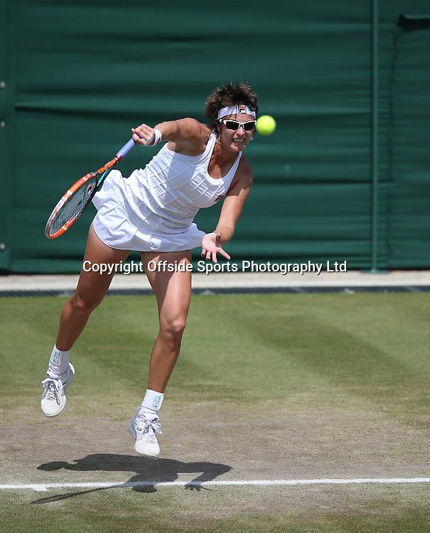 July 01 2014 Day  Eight: The Championships - Wimbledon 2014 <br /> Yaroslava Shvedova serves v Lisicki.<br /> Photo: Mark Leech