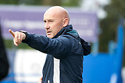 Colchester United manager John McGreal giving instructions to the Colchester players during the EFL Sky Bet League 2 match between Macclesfield Town and Colchester United at Moss Rose, Macclesfield, United Kingdom on 28 September 2019.