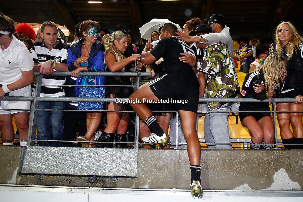 Charles Piutau jumps into the crowd. Hertz Wellington Sevens - Day two at Westpac Stadium, Wellington, New Zealand on Saturday, 4 February 2012. Photo: Ella Brockelsby / photosport.co.nz