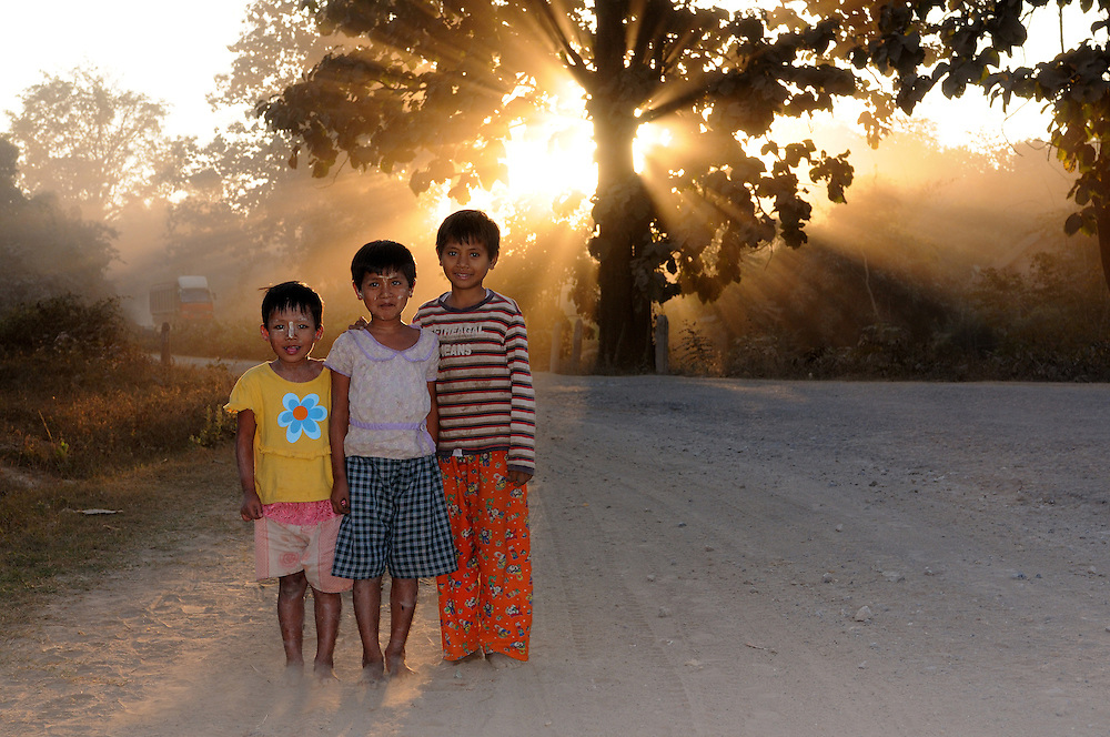 Children in the silhouette of the down going sun, near Kalaw, Myanmar,Asia