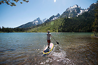 Ken Rizzotti, of Wilson, set out on his stand-up paddle board for an afternoon cruise on Jenny and String lakes in Grand Teton National Park.