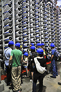 Desalination plant. Visitors stand next to a bank of Reverse Osmosis membrane filters. This facility turns salt water into drinking water using the Reverse Osmosis Process and will produce 127 million cubic metres of fresh water each year. Photographed in Hadera, Israel.