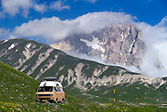 Gran Sasso National Park, Abruzzo, Italy, June 2008. A camper van at high altitude.  The green plains of Campo Impertore are surrounded by High mountains. Photo by Frits Meyst/Adventure4ever.com
