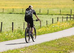 THEMENBILD - ein Frau fährt mit einem Mountainbike auf einem asphaltierten Radweg durch blühende Wiesen, aufgenommen am 23. Mai 2019, Kaprun, Österreich // a woman riding a mountain bike on an asphalted cycle path through flowering meadows on 2019/05/23, Kaprun, Austria. EXPA Pictures © 2019, PhotoCredit: EXPA/ Stefanie Oberhauser