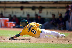 OAKLAND, CA - SEPTEMBER 22: Jed Lowrie #8 of the Oakland Athletics slides into home plate to score a run against the Minnesota Twins during the second inning at O.co Coliseum on September 22, 2013 in Oakland, California. The Oakland Athletics defeated the Minnesota Twins 11-7 as they clinched the American League West Division. (Photo by Jason O. Watson/Getty Images) *** Local Caption *** Jed Lowrie