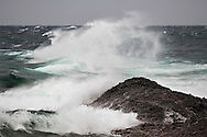 Large Lake Superior waves crash on the Keweenaw Peninsula near Copper Harbor Michigan.