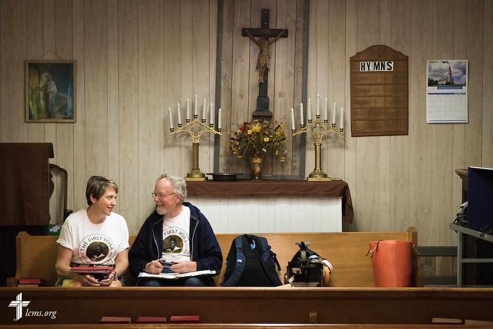 Kim Vieker, script supervisor, and her father and director Dr. Ardon Albrecht work together on set at Hope Lutheran Church near Selma, Ala., during filming of 'The First Rosa' documentary on Wednesday, Sept. 24, 2014. LCMS Communications/Erik M. Lunsford