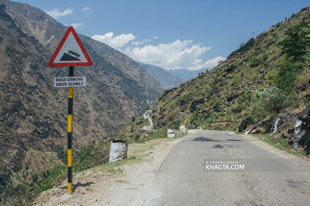 A road sign warning of a sinking road ahead near Jeuri, on the National Highway 22 to Kinnaur Valley in Himachal Pradesh