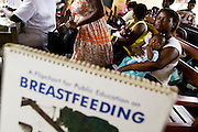Women and their children wait at the Osu Maternity Home in Accra, Ghana on Tuesday June 16, 2009.