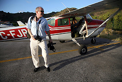 05 April 2011. St Maarten, Antilles, Caribbean.<br /> Sunday Telegraph reporter David Harrison steps from a 1962 Cessna used to cover Antiki Raft.<br /> After more than 9 weeks at sea, having started in the Canary islands, the 'Antiki' transatlantic raft gets set to arrive in St Maarten in the Caribbean following an epic voyage. The incredible vessel is crewed by Anthony Smith (84 yrs old) British adventurer, David Hildred, sailing master and British Virgin Islands resident, Dr Andrew Bainbridge of Alberta, Canada and John Russell, solicitor and UK resident.<br /> Photo; Charlie Varley/varleypix.com