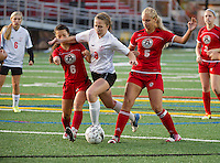 Laconia's Micheala Sorrell charges through Berlin defenders Kiara Law-As and Emma Dorval during NHIAA Division III Soccer Tuesday evening.  (Karen Bobotas/for the Laconia Daily Sun)