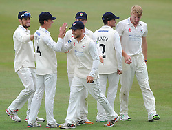 Chris Dent of Gloucestershire celebrates with his team mates after catching out Rob Keogh of Northamptonshire from Liam Norwell of Gloucestershire bowl - Photo mandatory by-line: Dougie Allward/JMP - Mobile: 07966 386802 - 08/07/2015 - SPORT - Cricket - Cheltenham - Cheltenham College - LV=County Championship 2