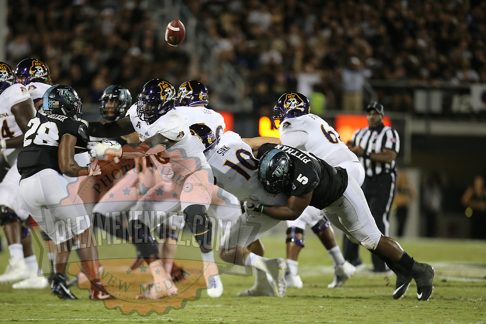 ORLANDO, FL - OCTOBER 14: Jamiyus Pittman #5 of the UCF Knights knocks the ball from the hands of Thomas Sirk #10 of the East Carolina Pirates during a NCAA football game between the East Carolina Pirates and the UCF Knights at Spectrum Stadium on October 14, 2017 in Orlando, Florida. (Photo by Alex Menendez/Getty Images)
