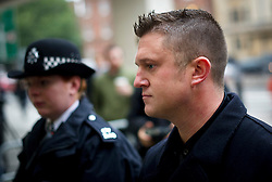 © London News Pictures. 16/10/2013. London, UK. Former Leader of the EDL (English Defence League) TOMMY ROBINSON (right) aka Stephen Yaxley-Lennon arriving at Westminster Magistrates Court in London where he is charged with obstructing police officers while taking part in a protest walk to Woolwich Barracks following the killing of Drummer Lee Rigby. Photo credit: Ben Cawthra/LNP