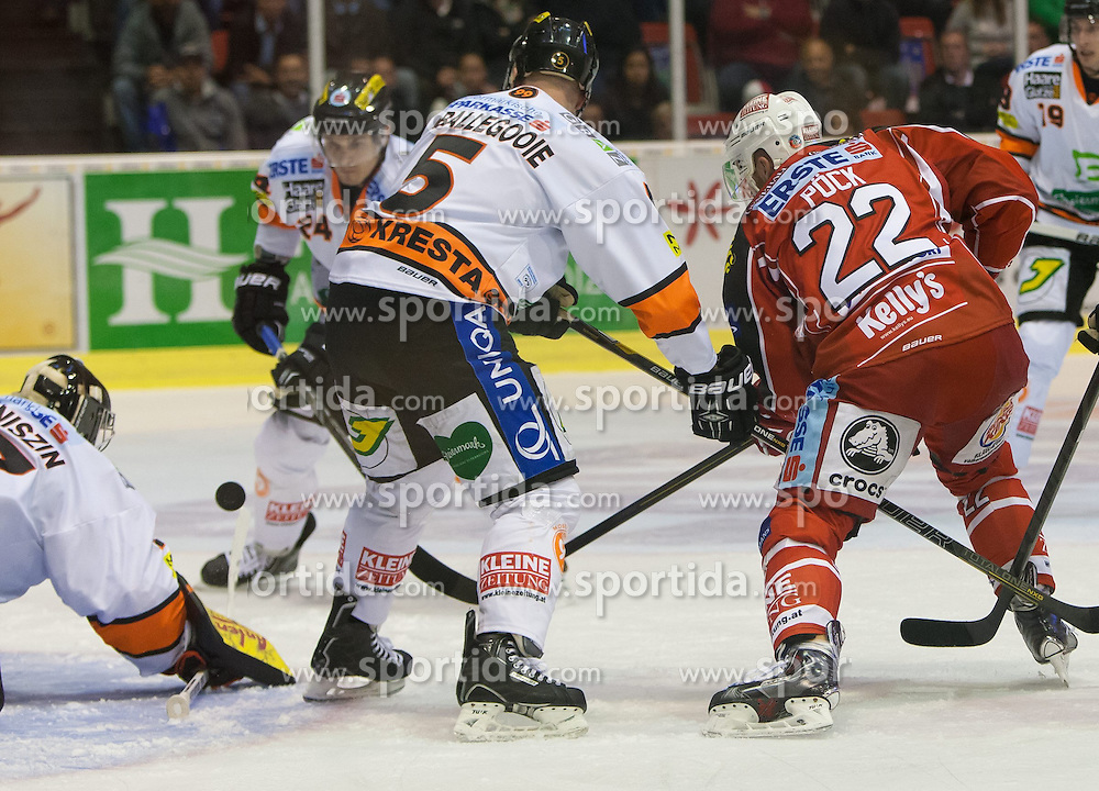 22.09.2013, Stadthalle, Klagenfurt, AUT, EBEL, EC KAC vs Graz 99, 9. Runde, im Bild Sebastian Stefaniszin (Graz 99ers, #27), Dustin VanBallegooie (Graz 99ers, #5), Kristoph Reinthaler (Graz 99ers, #24), Thomas Pöck (KAC, #22) // during the Erste Bank Icehockey League 9th Round match betweeen EC KAC and Graz 99 at the City Hall, Klagenfurt, Austria on 2013/09/22