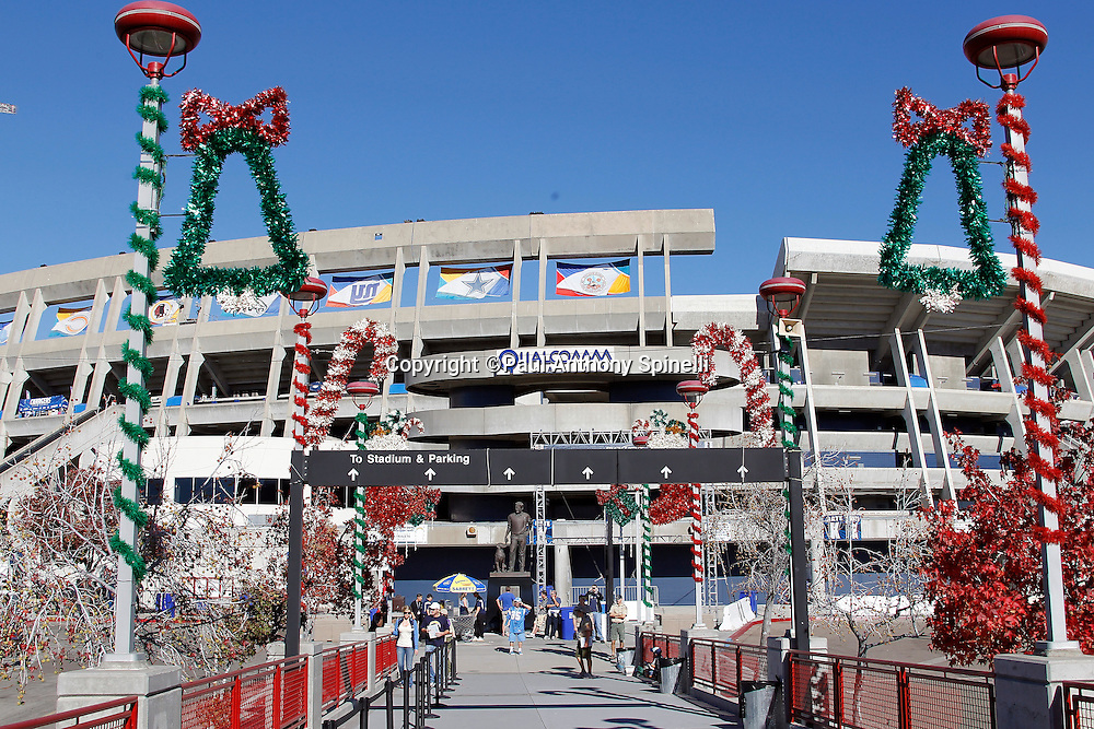 Christmas decorations line the walkway as San Diego Chargers fans begin to leave the train station and walk toward Qualcomm Stadium for the Chargers NFL week 14 football game against the Kansas City Chiefs on Sunday, December 12, 2010 in San Diego, California. The Chargers won the game 31-0. (©Paul Anthony Spinelli)