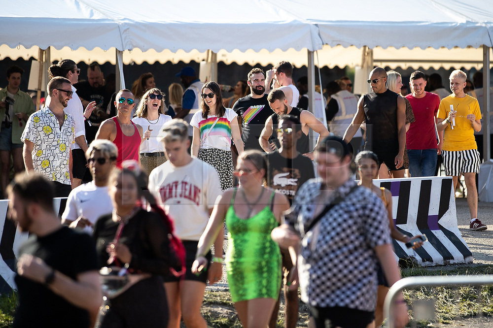 © Licensed to London News Pictures . 25/08/2019. Manchester, UK. Fans of Ariana Grande and other musical acts arrive through security at Mayfield Depot ahead of performances this evening . Manchester's annual Gay Pride festival , which is the largest of its type in Europe , celebrates LGBTQ+ life . Photo credit: Joel Goodman/LNP
