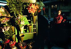 BUENOS AIRES, ARGENTINA: A man stands outside a market where flowers sold in a  Buenos Aires  market July 27, 2001. (Photo by Ami Vitale)BUENOS AIRES, ARGENTINA..(Photo by Ami Vitale)