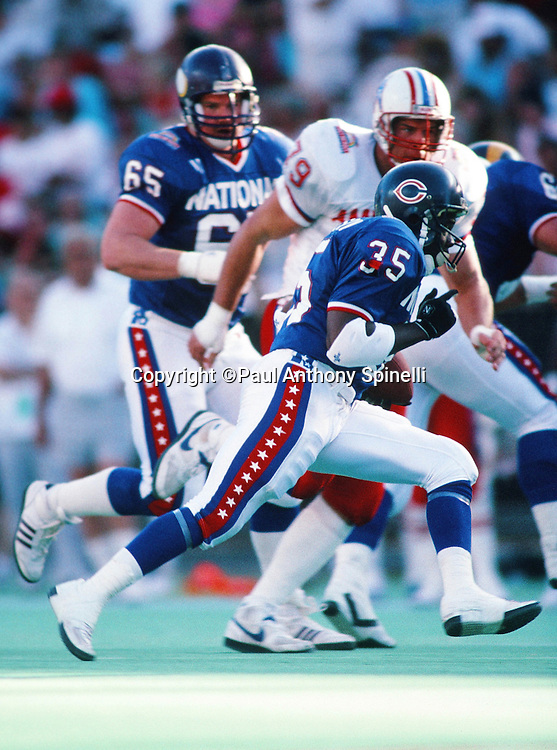 The National Football Conference Chicago Bears running back Neal Anderson (35) runs the ball during the 1989 NFL Pro Bowl football game against the American Football Conference on Jan. 29, 1989 in Honolulu. The NFC won the game 34-3. (©Paul Anthony Spinelli)