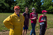 Students in Science class at Jenks Public Schools are learning about the importance of fire on the ecosystem. Students watched a prescribed fire and toured and made observations of the natural areas that have been burned during different times over the past  few years and compared those to areas left unburned. OSU faculty member John Weir cooperating with Bryan Yockers, faculty member at Jenks High school, have created a burn demonstration and research park near the city of Jenks.