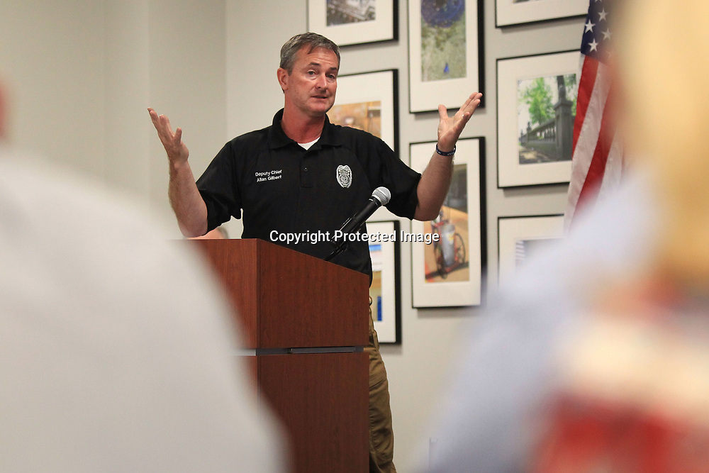 Allan Gilbert, Tupelo Deputy Police Chief, speaks with participants of the citizens police academy during thier culmination ceremony Monday night at the Tupelo Police Department.